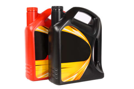 lubrication: two bottle of engine oil with white background