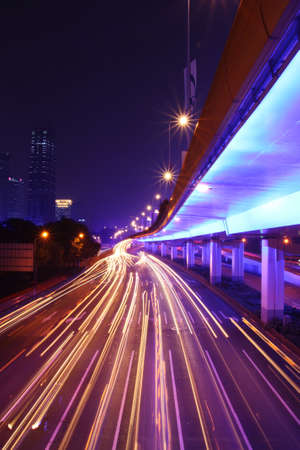 urban road: night highway connection with light traces from moving cars,shanghai,china