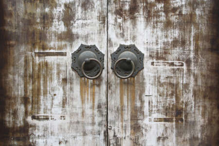 oriental traditional wood door and knocker photo