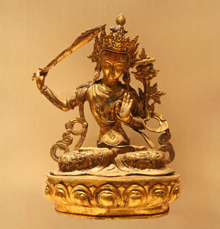 enlightened: copper statue of the Manjushri bodhisattva.within tibetan buddhism, Manjushri is a tantric meditational deity or Yidam,and considered a fully enlightened buddha.