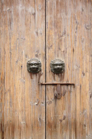 chinese traditional wood door with beast head and knocker photo