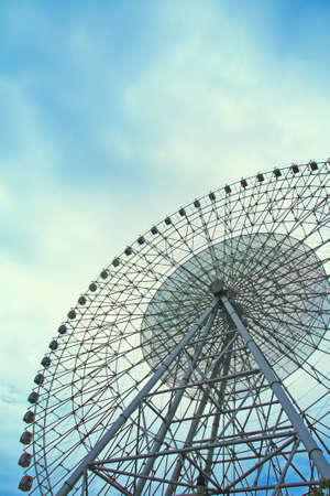 acrophobia: ferris wheel on blue sky