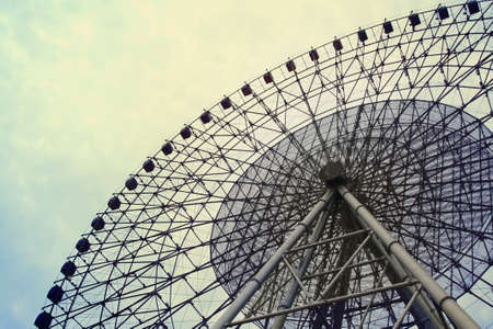 a big ferris wheel on the cloudy sky  photo