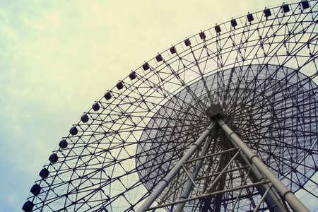 big wheel: a big ferris wheel on the cloudy sky