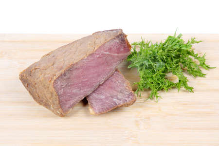 cooked  ribeye beef and green vegetables leaves on the chopping board Stock Photo - 8685049