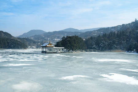 frozen trees: winter landscape with lake covered with ice. lushan ,China