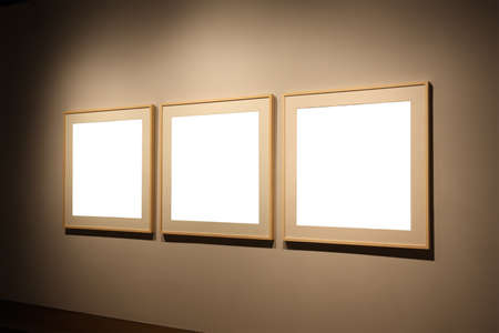 art exhibition: three empty frames on the exhibition wall