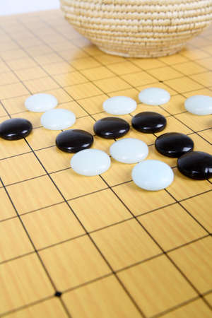 mind game: features on the game of go,  to play a game of go chess. Stock Photo