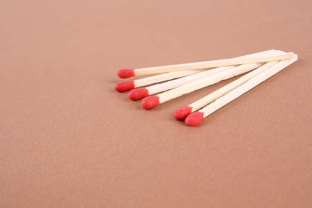 close up of the six matches isolated on yellow background photo