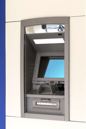 automated teller machine on the wall photo