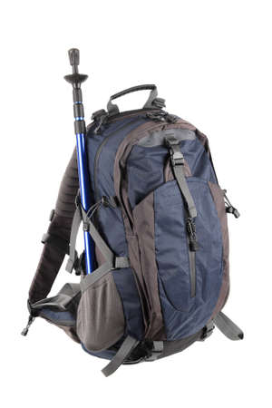 backpack and hiking pole isolated on white photo