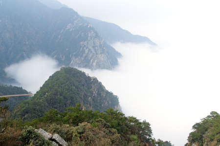 mountain ranges: the mountain ranges are covered in cloud and mist