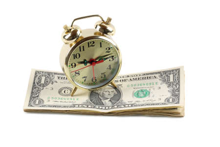 time is money,golden alarm clock and dollar. photo