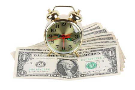 golden alarm clock on U.S. dollar photo