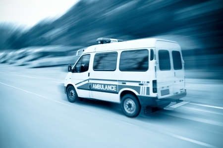 infirmary: an ambulance driving fast on the highway Stock Photo