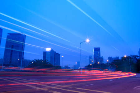 light trails on the building background in shenzhen,China Stock Photo - 9582693