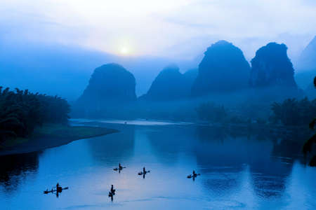 sunrise with bamboo raft  at Yangshuo on the Li River, China  photo