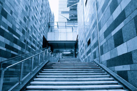 staircase between the modern building  photo