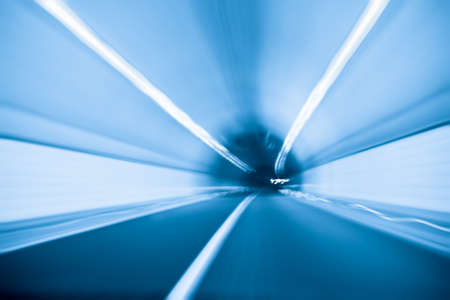 front of an inside tunnel with blue tone photo