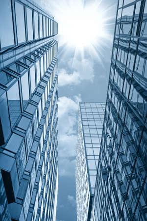 modern glass building under the sun in hong kong  photo