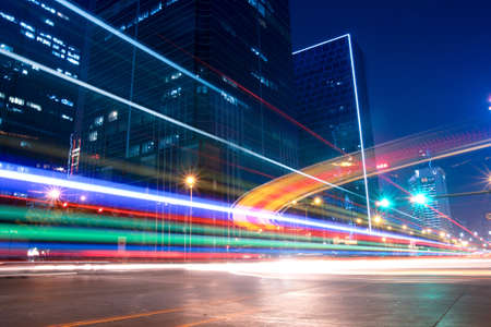light trails with blurred colors on the street at night Stock Photo - 9777061