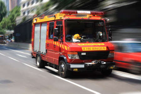fire truck: fire engine rushing down the street to the rescue  Stock Photo