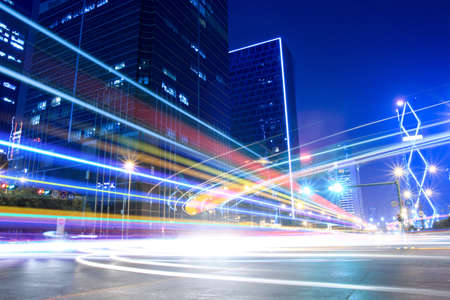 light trails: light trails on the modern city street at night  Stock Photo