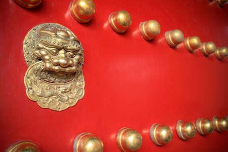 knocker: gilt lion knocker on the red door in the forbidden city
