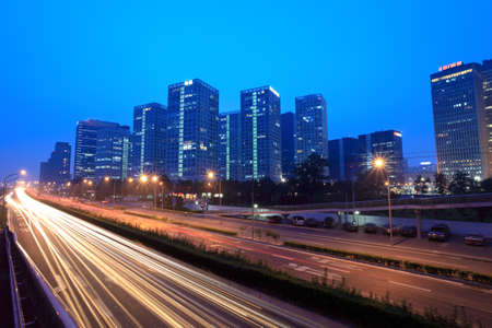 light trails on the highway at dusk in beijing,China  photo
