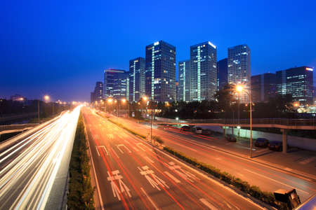 bustling: night traffic with modern cityscape in beijing,China