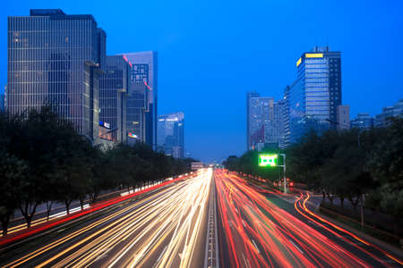 light trails on the street at dusk in beijing,China  photo