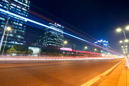 street lamp: modern urban city at night with street traffic in beijing,China