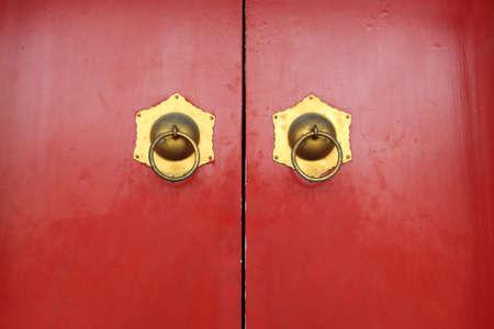 red door: red door and door knockers in the palace