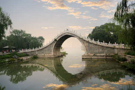 beautiful stone arch bridge at the summer palace in beijing, China