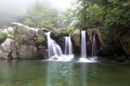 beautiful waterfall at the black dragon pool in lushan,China photo