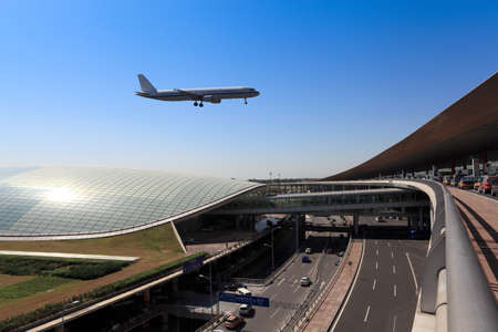 airport business: flight arrival  in beijing capital airport