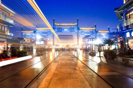 tramcar: light trails of the traditional tramcar through the old commercial street at night in beijing Stock Photo