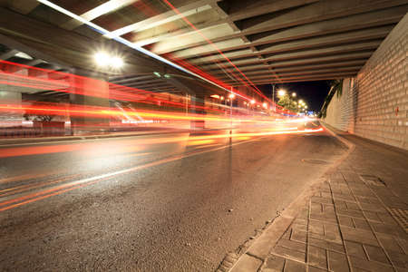 light trails: light trails under the viaduct at night Stock Photo