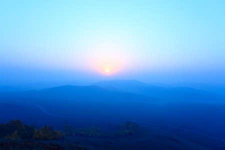 blue ridge mountains in sunrise at grassland photo