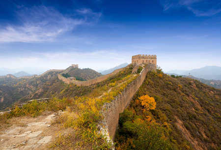 the great wall of china against a blue sky in autumn