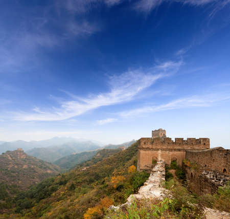 the great wall of china in autumn against a blue sky