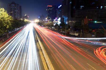 light trails on rush hour traffic at night in beijing,China photo
