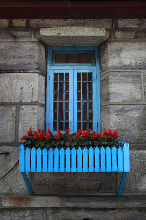 the window of the old villa and flowers photo
