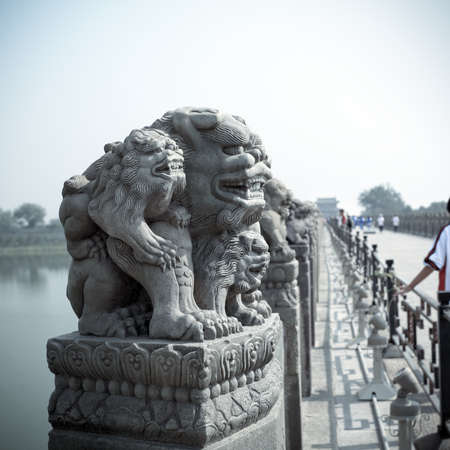 chinese marco polo bridge of the stone lion statue photo