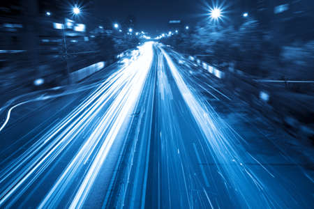 light trails on the street in rush hour traffic at night photo