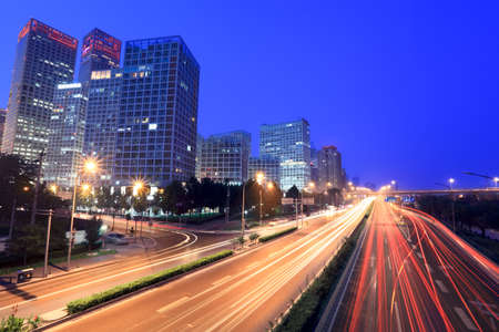 modern cityscape at dusk with traffic in beijing, China photo