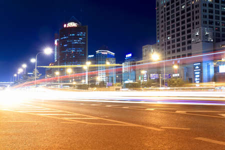 streets with heavy traffic at night in beijing,China photo