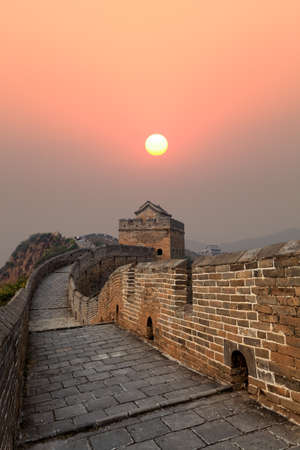 the great wall of china at autumn sunset Stock Photo