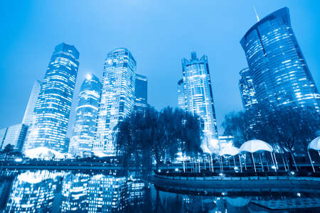night scene of the lujiazui central green land in shanghai,China photo