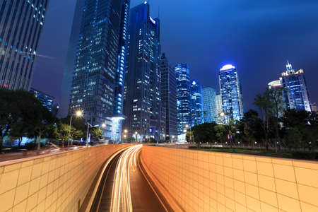 night view of modern building and tunnel in shanghai,China. photo
